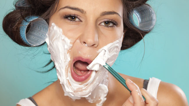 woman shaving face